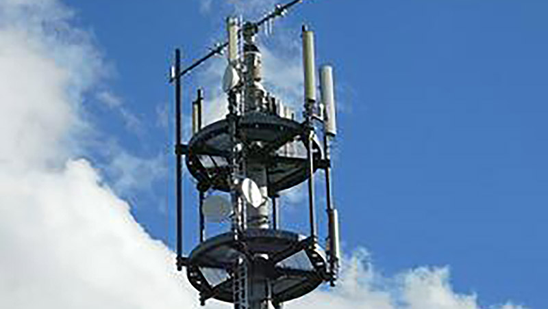 Large antenna with sky in the background